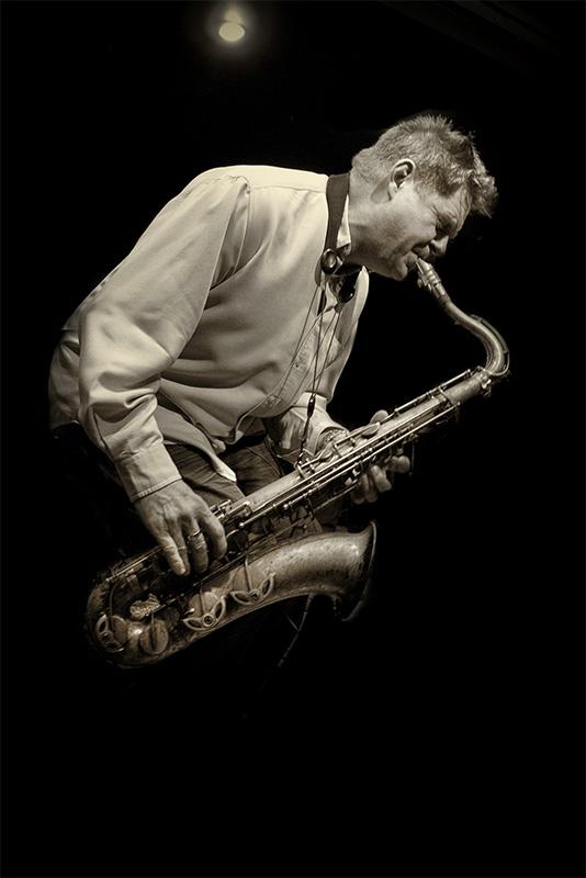 Derek Nash on saxophone
