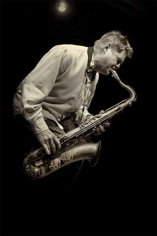 Derek Nash on saxophone